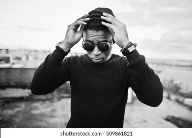 Portrait of  style black man on the roof. Black and white photo