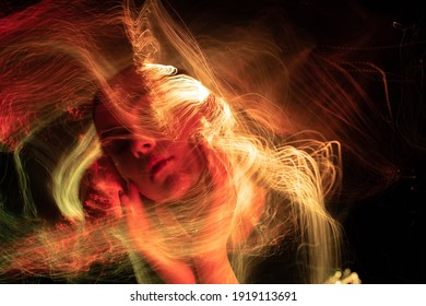 Portrait in the style of light painting. Long exposure photo, abstract portrait