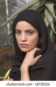 Portrait style shot of a beautiful woman wearing a headscarf or hijab