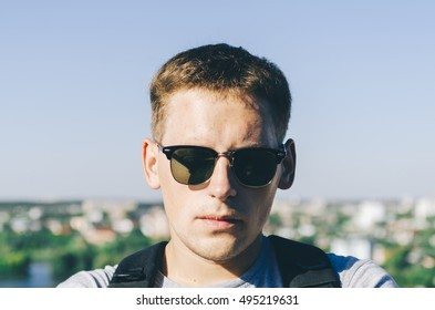 Portrait of style young man on the roof