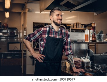 Portrait of stylish bearded cook on a kitchen.