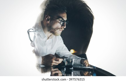 Portrait of stylish bearded lawyer wearing glasses and looking city. Double exposure, businessman working laptop at night, texting smartphone background. Isolated white. Horizontal