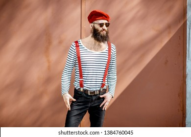 008dc22324d Portrait of a stylish bearded man dressed in striped shirt