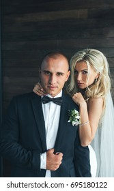 portrait of stylish blonde bride and groom