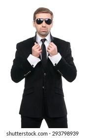 Portrait of stylish bodyguard with sunglasses. Isolated over white background