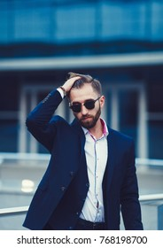 Portrait of a stylish businessman in sunglasses