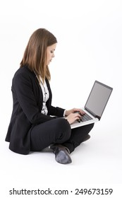 Portrait of a stylish Businesswoman using a laptop. Isolated on white background. Caucasian brunette female model.