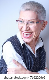 Portrait of a stylish, classy senior older woman laughing