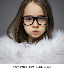 Portrait of stylish fashionista little girl face