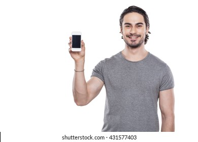 Portrait of stylish handsome young man isolated on white background. Man showing mobile phone and smiling