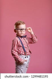 Portrait of stylish little boy. Little child in glasses has idea. Kid isolated on pink blackboard. Success, bright idea, creative ideas and innovation technology concept.