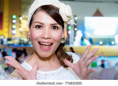 Portrait of stylish pretty woman in white dress with greast gatsby dresses for theme white party, Enjoying her holidays and relax at night party, Bright white dress and color, Positive and happy mood,