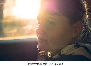 Portrait of stylish smiling happy, cheerful, positive, laughing woman travel and dreaming by car with sunlight. Life balance concept lifestile.