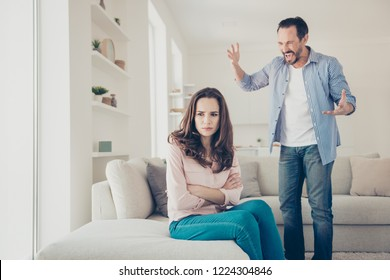 Portrait of stylish trendy couple having big drunk fight misunderstood indoors in modern light interior apartments hotel house