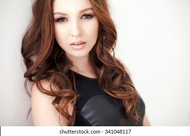 portrait of stylish woman in black leather dress, isolated on white - Shutterstock ID 341048117