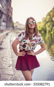 Portrait of stylish woman street style wearing Marsala skirt