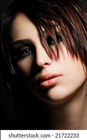 Portrait of stylish young adult girl. Creativity make-up and hairstyle