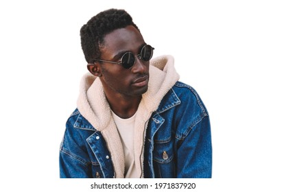 Portrait of stylish young african man model wearing denim jacket isolated on a white background