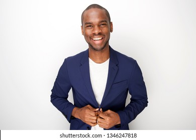 Portrait of stylish young black man in blazer jacket against white background