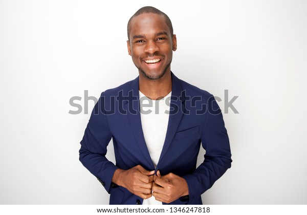 Portrait of stylish young black man in blazer jacket against white background