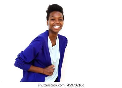 Portrait of stylish young female fashion model posing against white background