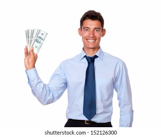 Portrait of a stylish young man holding cash dollars on isolated background