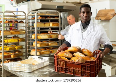 Portrait of successful baker during daily work in bakeshop