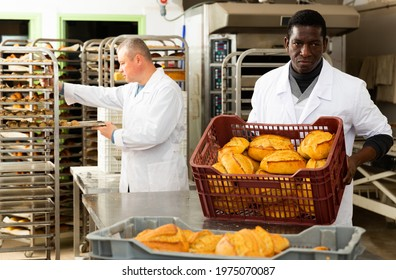 Portrait of successful baker during daily work in bakeshop. High quality photo