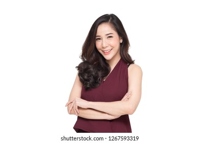Portrait of successful business asian women in red dress with arms crossed and smile isolated over white background, Young businesswoman smiling and looking at camera, Happy feeling concept