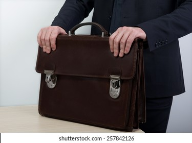 Portrait of successful business man with bag in dirty grey background and space for text, Closeup Of Businessman Holding Briefcase, man with bag,Business man hands with briefcase