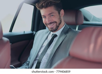 Portrait of a successful business man in his car