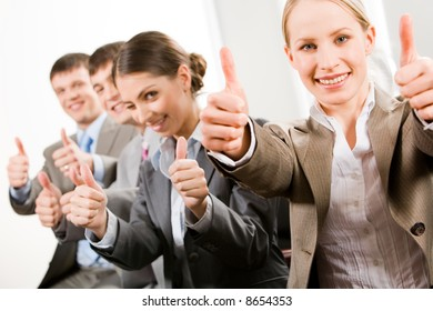 Portrait of successful business people showing a sing of okay