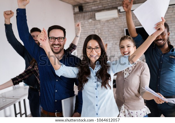 Portrait of successful business team posing in office
