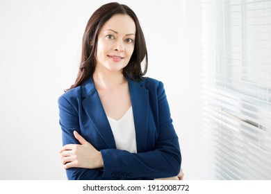 Portrait of successful business woman against a window.
