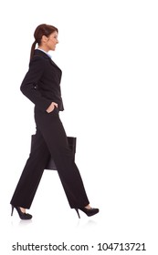 Portrait of successful business woman walking with a briefcase - White background