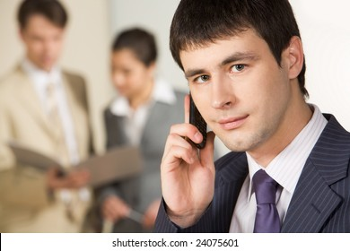 Portrait of successful businessman calling on mobile phone