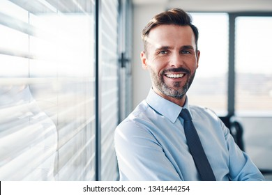 Portrait of successful businessman in modern office