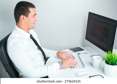 portrait of a successful businessman at office working on computer