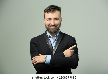 Portrait of successful businessman on light background