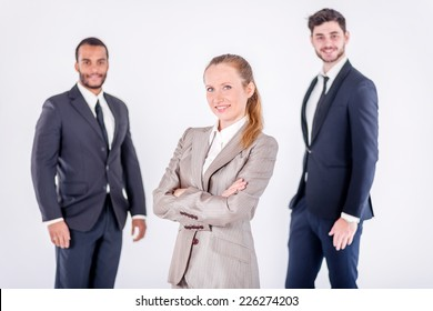 Portrait of a successful businessman. Three confident and successful businessman standing with folded hands on an isolated gray background