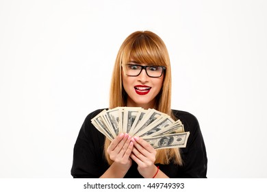 Portrait of successful businesswoman holding money over white background.
