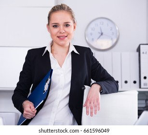 Portrait of successful confident business woman in office interior