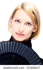 Portrait of a successful,  elegant, attractive, business woman wearing black blouse holding folding fan.