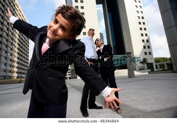 Portrait of successful family businesspeople near a office building having fun