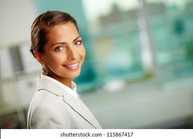 Portrait of successful female looking at camera with smile