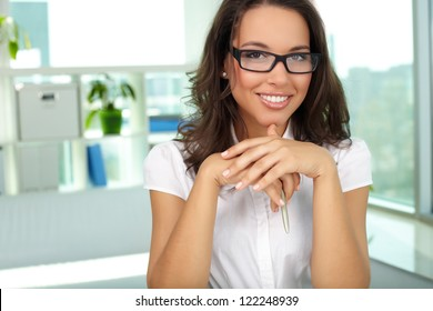 Portrait of successful female looking at camera in office