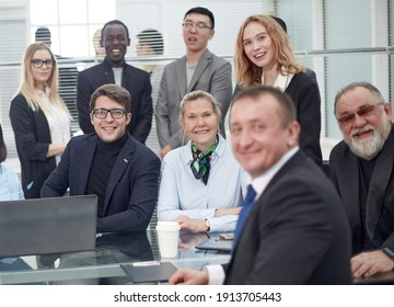 Portrait of successful group of business people at modern office. Happy businessmen and satisfied businesswomen standing as a team in office