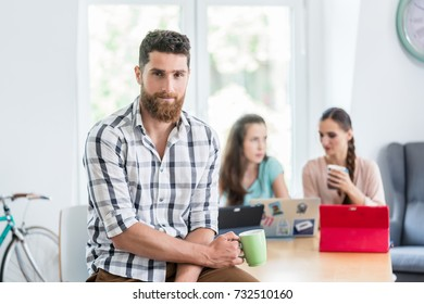 Portrait of a successful independent contractor looking at camera with professional confidence in the shared office of a modern co-working space