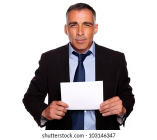 Portrait of a successful manager looking and holding a white card with copyspace on isolated background