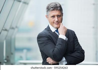 Portrait of successful middle aged businessman